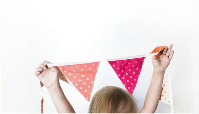 A child putting up bunting. Image copyright: Kayla Butler, ivory mix.com.