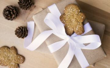 A wrapped gift and gingerbread men. Photo copyright: Kayla Butler via ivory mix.com.