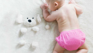 A baby in a nappy. Photo: unsplash.com.