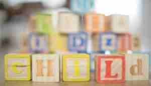 Wooden blocks reading 'child'. Photo: Pixabay..