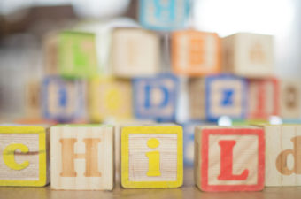 Wooden blocks reading 'child'. Photo: Pixabay..