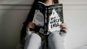 A child reading a chapter book. Photo: Annie Spratt, via Unsplash.com.