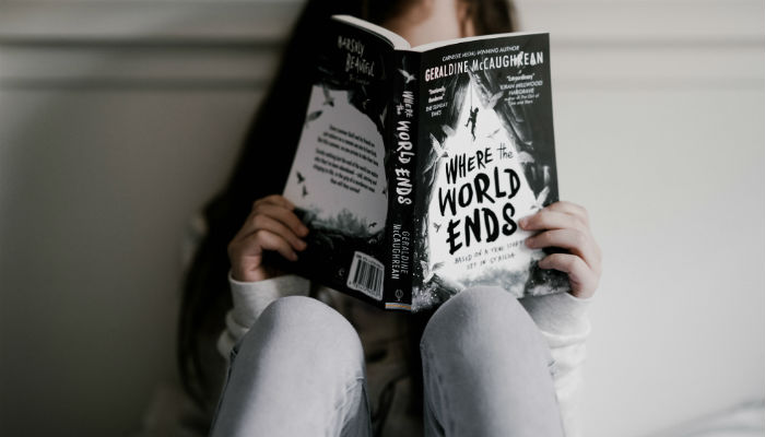 A child reading a chapter book. Photo: Annie Spratt, via Unsplash.com.