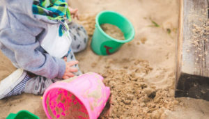 A child playing in the sand. Photo by Kaboompics.com from Pexels.