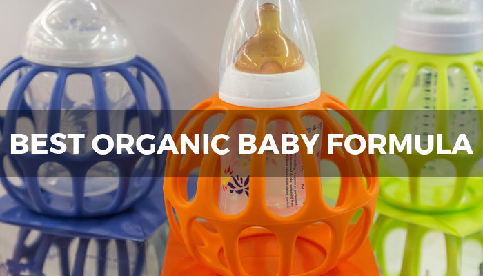 Baby formula bottles, with text overload reading 'Best organic baby formula guide'. Image: Laura21de on Pixabay.com.