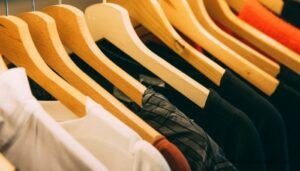 Eco friendly clothing on hangers. Image copyright Kai Pilger, via Pexels.com.