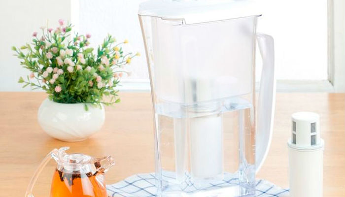 Glass water filter jug.