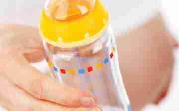 A glass baby bottle. Image copyright: Public Domain Pictures via Pexels.com.