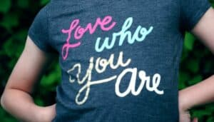 A t shirt reading Love Who You Are - an inspirational quote for children. Image copyright: Sharon Mccutcheon via unsplash.com.