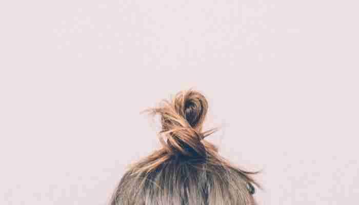 A woman's hair style. Photo by Tookapic via Pexels.